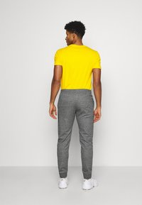 Champion - CUFF PANTS - Tracksuit bottoms - mottled dark grey - 2