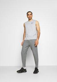 Nike Performance - DRY PANT RESTORE - Pantalones deportivos - iron grey heather/black - 1