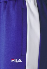 Fila - ALKAS TRACK PANT - Trousers - clematis blue/bright white - 6