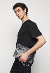 Just Cavalli - BAND WITH A CONTRAST LOGO - Bum bag - black - 1