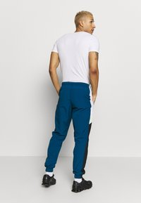 Nike Sportswear - PANT SIGNATURE - Verryttelyhousut - blue force/black/white - 2