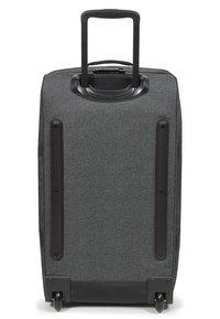 Eastpak - TRANVERZ - Wheeled suitcase - black denim - 3