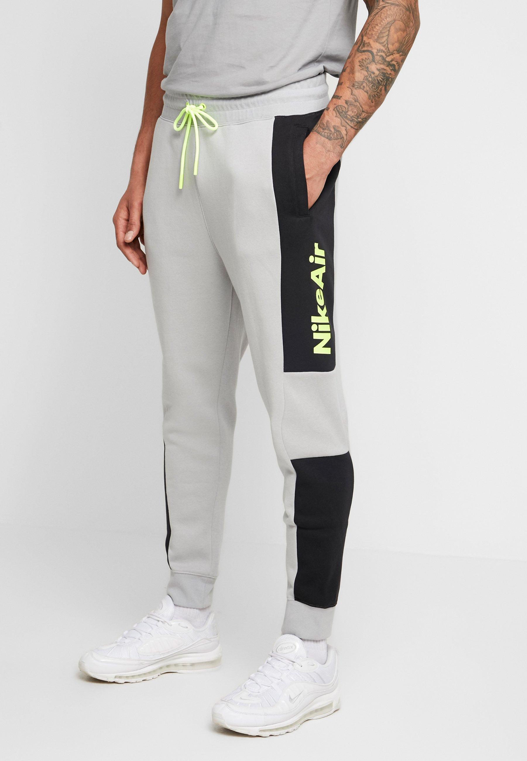 escucha Oclusión tela  Nike Sportswear M NSW NIKE AIR PANT FLC - Pantalon de survêtement - smoke  grey/black/volt/gris clair - ZALANDO.FR