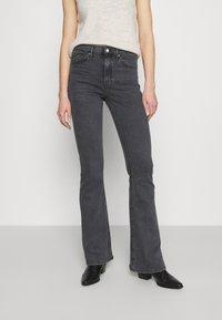 Topshop - JAMIE FLARE - Flared Jeans - washed black - 0
