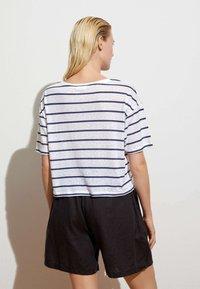 OYSHO - Print T-shirt - dark blue - 1