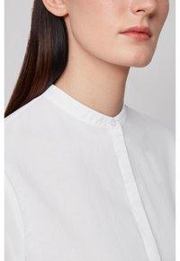 BOSS - EFELIZE - Button-down blouse - white - 4