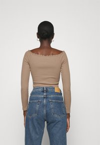 Abercrombie & Fitch - RUFFLE BODYSUIT - Long sleeved top - light brown - 2