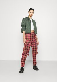 The Ragged Priest - CHECK PANTS WITH EYELET STRAPS AND BUCKLES - Trousers - red/multi - 1