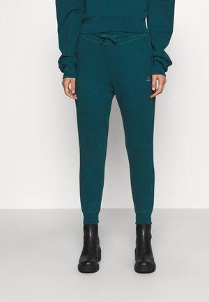 CLASSIC - Teplákové kalhoty - green