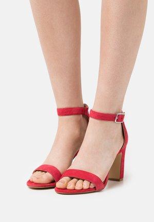High heeled sandals - framboise