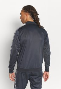 Umbro - ACTIVE STYLE TAPED TRACKSUIT - Tracksuit - indian ink/white - 2