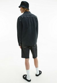 Calvin Klein Jeans - Vapaa-ajan kauluspaita - denim black - 6