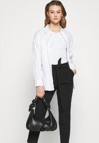 ONLY - ONLFRESH PAPERBAG PANT  - Kalhoty - black - 3