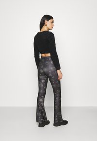 Topshop - ASTROLOGY FLARE - Leggings - Trousers - black - 2
