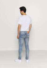 Levi's® - 519™ SKINNY BALL - Jeansy Skinny Fit - light-blue denim - 2
