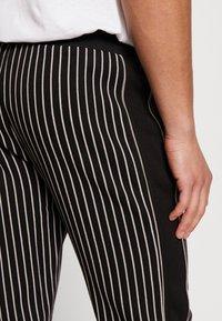 Burton Menswear London - PINSTRIPE - Tracksuit bottoms - black - 3