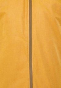 REVOLUTION - PADDED WINDBREAKER - Light jacket - brown - 2