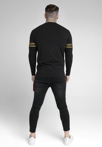 SIKSILK - TECH SCRIPT TEE - Long sleeved top - black/gold - 2