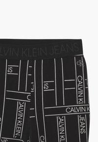 Calvin Klein Jeans - LOGO TAPE - Leggings - Trousers - black - 2
