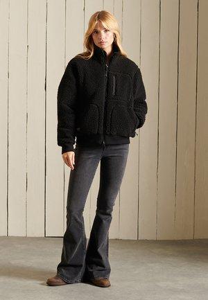 SHERPA - Fleece jacket - black