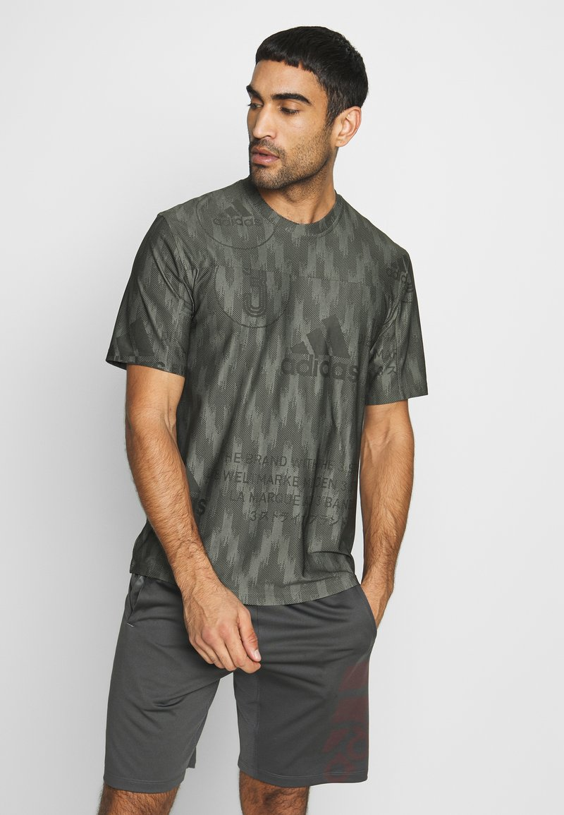 adidas Performance - CITY TEE - T-shirts med print - green