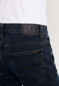 Nudie Jeans - TIGHT TERRY - Džíny Slim Fit - black ocean - 4