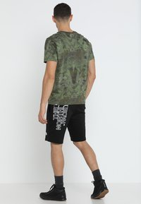 The North Face - MENS GRAPHIC SHORT  - Sports shorts - black - 2
