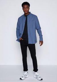 Dr.Denim - CHASE - Slim fit jeans - black - 1
