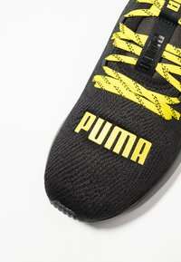 Puma - HYBRID NX CAUTION - Neutral running shoes - black/blazing yellow - 5