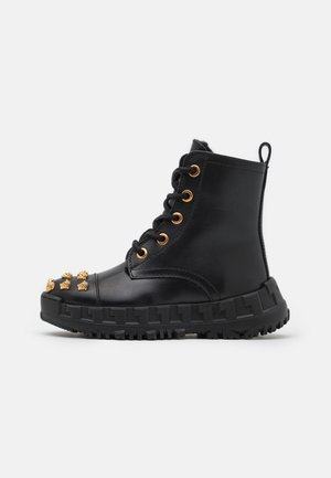 Lace-up ankle boots - nero/oro