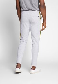 Lacoste - Tracksuit bottoms - silver chine/jonquille-black - 2