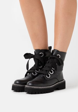 PAVVILLION - Platform ankle boots - black