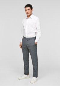 s.Oliver BLACK LABEL - Pantaloni eleganti - dark blue check - 0