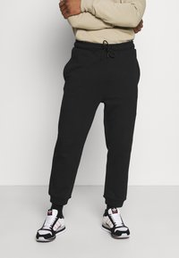 K-Way - ANDRE UNISEX - Trousers - black - 0