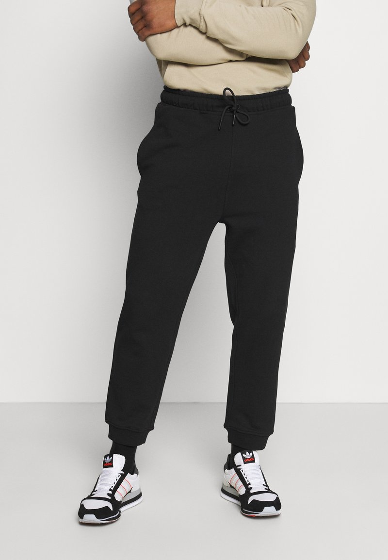 K-Way - ANDRE UNISEX - Trousers - black