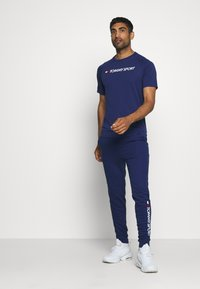 Tommy Hilfiger - CUFF PANT LOGO - Tracksuit bottoms - blue - 1