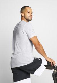 Nike Performance - TEE ATHLETE - Camiseta estampada - white/university red - 4