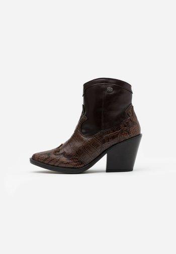BRAMI - Ankle boots - dark brown