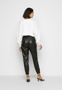 ONLY Petite - ONLMADY-CALLEE  - Trousers - black - 2
