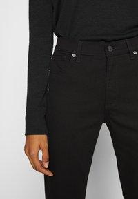 GAP - Bootcut jeans - true black - 4