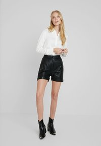 Cream - VICTORIA - Leather trousers - pitch black - 1