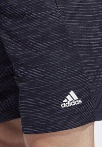adidas Performance - 4KRFT SPORT STRIPED HEATHER SHORTS - Sports shorts - blue - 4