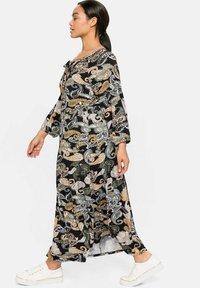 Sheego - Maxi dress - schwarz gemustert - 1