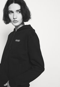 HUGO - DAKOTO - Zip-up hoodie - black - 3