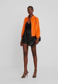 Ibana - FEAST - Leather trousers - black - 1