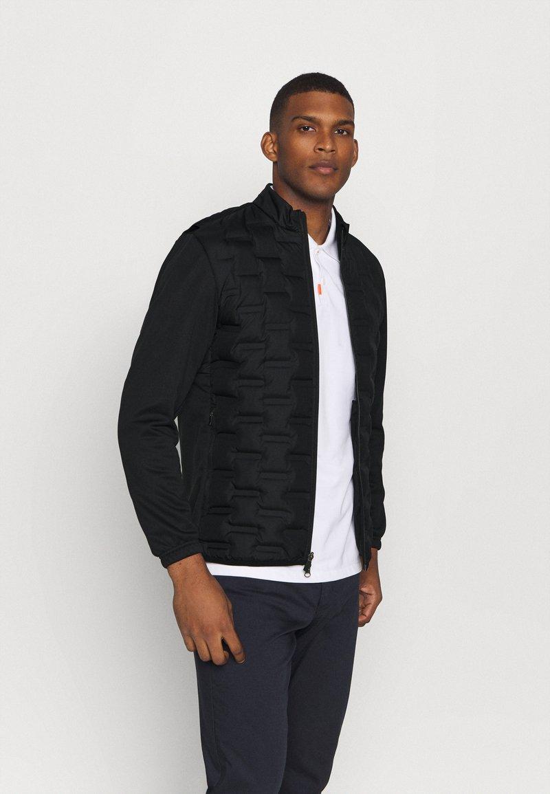 Nike Golf - Bunda zprachového peří - black