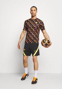 Nike Performance - AS ROM  - Club wear - black/university gold - 1