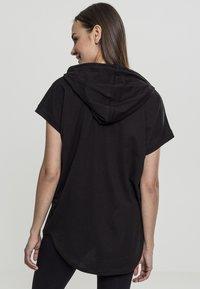 Urban Classics - LADIES SLEEVELESS HOODY - Print T-shirt - black - 1