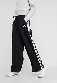 adidas Performance - WIDE PANT - Träningsbyxor - black - 0