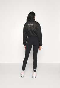 Nike Sportswear - LEGASEE ZIP - Leggings - black/white - 2
